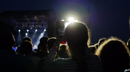 alfândega : fan take mobile foto, people shoots video using phone on concert, fans at live music concert, colourful lights on stage, colorful lighting during night rock concert, slow motion