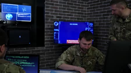 safeness : professionals soldiers in uniform, in field headquarters, Cyber war strategy, attack security virus infection, satellite surveillance monitor screen, on background monitor and employees, War center