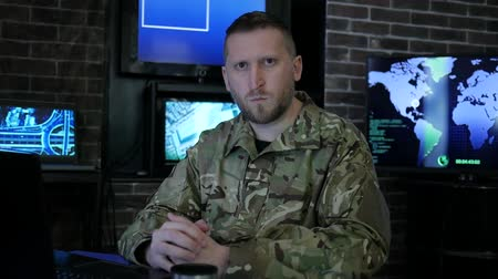 safeness : portrait commander male in shape, in monitoring room, military control and security service, safety system tracking terrorists, on background Workstation, beside monitor and employees, War center Stock Footage