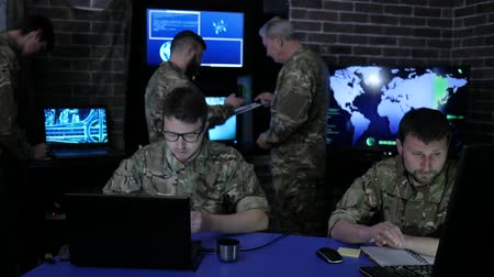 safeness : War headquarters, experimental general beside from military group, in control room, working process at briefing, discussing military control, on background monitor screen and group people at uniform