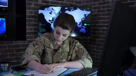 safeness : woman portrait soldier with computer, IT war, cyber safety, technical control, tracking system, strategy warfare, field headquarters, military staff, attack and security, control center