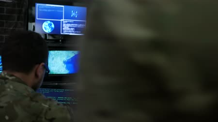 safeness : warning, attack and safeness headquarters, IT war discussing battle strategy holding laptop, cyber safety on background monitor, computer on military headquarter or war base, control center