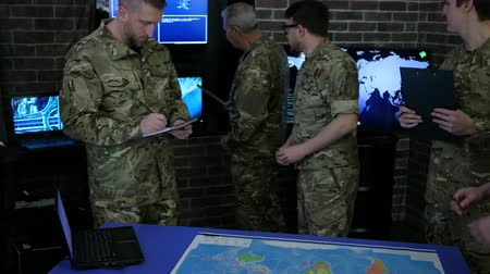anti terrorism : team military IT professionals people in uniform, control apartment, security service, view world map, on Briefing in monitoring room, on manages station on war base, military control