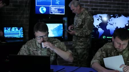 safeness : security service, experienced general and group Military IT Professionals people in uniform, on Briefing in monitoring room, on manages station, on war base, dispatch apartment