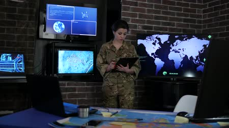 searches : portrait woman soldier with tablet, against background electronic monitors, cyber safety, technical control, tracking system, military staff, attack and security, control center, war base, IT war,