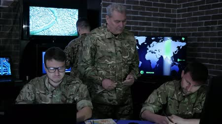 штаб квартира : military control, war base, group military IT professionals, on briefing, in monitoring room, on military base, employees in uniform, group people beside Computer and monitor screen,