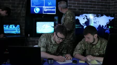 safeness : dispatch apartment, security service, experienced general and group Military IT Professionals people in uniform, on Briefing in monitoring room, on manages station, on war base,