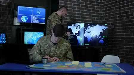 safeness : briefing, discussing battle strategy holding digital tablet, team IT specialists, on military headquarter or war base, security service, cyber safety, attack and safeness headquarters, working process, Stock Footage