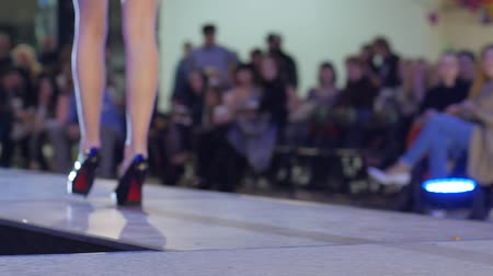 showcasing designs : female model in high heels and bikini, model in lingerie and black shoes walking along podium on fashion show, stylish footwear on women feets, collections shoes at fashion week Stock Footage