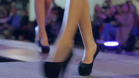 showcasing designs : collections shoes at fashion week, beautiful female legs in high heels on fashion show, stylish footwear on women feets, models walking down podium during fashion event