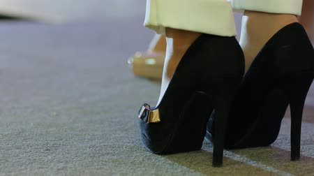 high heeled sandals : Fashion show. Presentation Collections shoes. Models walk on catwalk in high heels. Catwalk models. Models walk on catwalk at fashion show unfocused dis-focused. Close-up of shoes.