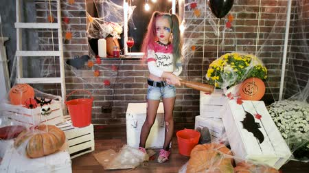 žolík : dangerous kid, harley quinn halloween costume, little girl having fun at all saints day masquerade, crazy killer, trick or treat, horror night, halloween party celebration, autumn holiday, horror