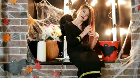 perverso : halloween celebration, young witch preraring to horror party, teen wearing costume, time of trick or treat, october traditional holiday, halloween party, masquerade at all saints day, decorated place Vídeos