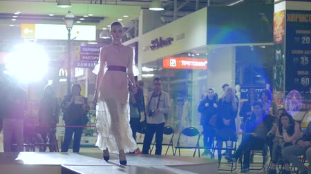 showcasing designs : Kherson, Ukraine 22 Apr. 2017: Fashion Weekend in Fabrika Mall style and fashion, beautiful model go on podium in Kherson, 22 Apr. 2017. model in exclusive apparel, professional girl going along catwalk, fashion defile show