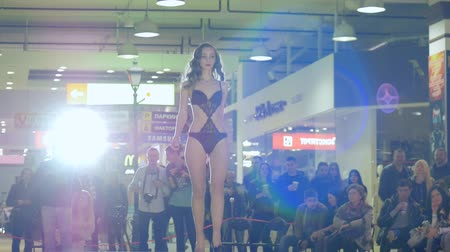 showcasing designs : Kherson, Ukraine 22 Apr. 2017: Fashion Weekend in Fabrika Mall presentation sexy underwear, fashion girl in undergarment going along catwalk in Kherson, 22 Apr. 2017. beautiful model in lingerie go on podium, fashion defile show