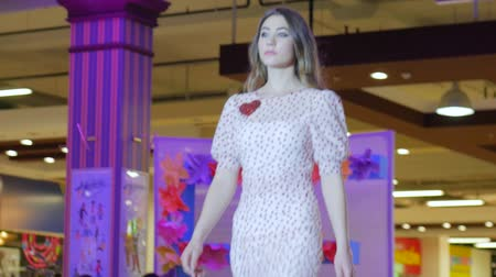 showcasing designs : Kherson, Ukraine 22 Apr. 2017: Fashion Weekend in Fabrika Mall fashion, model pose on catwalk at dress, fashion show in Kherson, 22 Apr. 2017. professional model on new clothes going along podium in spotlight, close-up