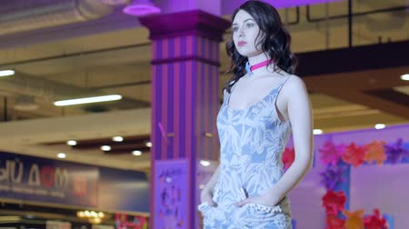 showcasing designs : Kherson, Ukraine 22 Apr. 2017: Fashion Weekend in Fabrika Mall fashion week, model professionally pose on catwalk in dress in Kherson, 22 Apr. 2017. fashion show, professional model in new clothes going along podium