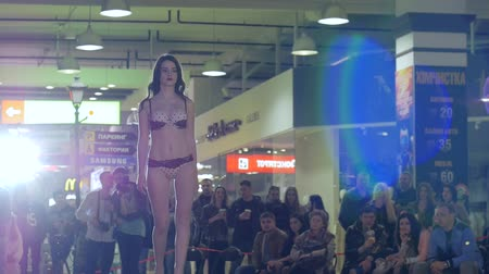 showcasing designs : Kherson, Ukraine 22 Apr. 2017: Fashion Weekend in Fabrika Mall fashion girl in lingerie going along catwalk, slow motion in Kherson, 22 Apr. 2017. presentation undergarment, sexy model go on podium, fashion defile show