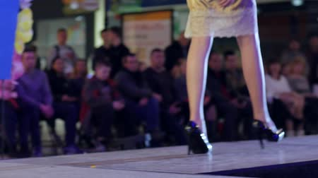 showcasing designs : Kherson, Ukraine 22 Apr. 2017: Fashion Weekend in Fabrika Mall collections shoes, model in high heels on catwalk in dress in Kherson, 22 Apr. 2017. model going along podium, close-up of shoes, beautiful female legs