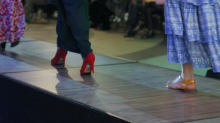 showcasing designs : Kherson, Ukraine 22 Apr. 2017: Fashion Weekend in Fabrika Mall close-up of shoes on podium, beautiful female legs, collections shoes in Kherson, 22 Apr. 2017. models in high heels on catwalk in dress, models going along podium