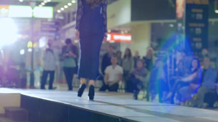 showcasing designs : Kherson, Ukraine 22 Apr. 2017: Fashion Weekend in Fabrika Mall close-up black shoes, beautiful female model in high heels on catwalk in evening dress in Kherson, 22 Apr. 2017. fashion model going along podium, slow motion