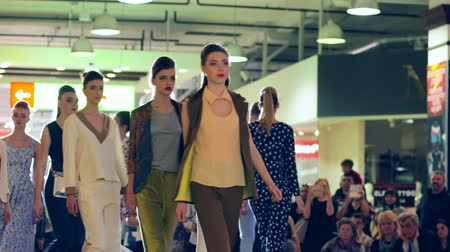 high heeled sandals : Kherson, Ukraine 22 Apr. 2017: Fashion Weekend in Fabrika Mall fashion week, group of models on show of new clothes go on catwalk in Kherson, 22 Apr. 2017. presentation of new collection clothing on podium, Defile of woman suits,
