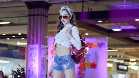 high heeled sandals : Kherson, Ukraine 22 Apr. 2017: Fashion Weekend in Fabrika Mall Model in shirt and denim shorts and sunglasses on catwalk in Kherson, 22 Apr. 2017. fashion Defile show of stylish clothes On podium, Fashion business,