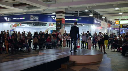 supermodel : Kherson, Ukraine 22 Apr. 2017: Fashion Weekend in Fabrika Mall Guy model in tuxedo walking on catwalk, Defile of Man in dinner jacket on podium in Kherson, 22 Apr. 2017. Presentation of mens clothing on Fashion Week,