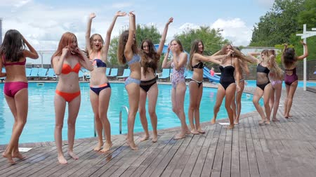 barefooted : summer life of youth on weekend, smiling girlfriends in Swimsuit Have fun near Poolside, Crowd of woman on resort, pool party, Slender girls in bathing suits jumping near swimming pool, Stock Footage