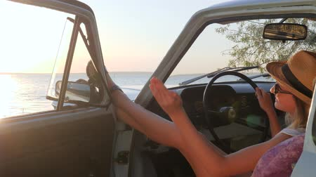 mirror glass : nice girl Waving come with me behind wheel auto In sunlight, Happy journey of Young woman at front seat of car on coast sea, Summer travel on vehicle of Sweet feminine on river, traveling together Stock Footage