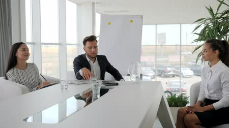 spolupracovníci : personnel management, boss with secretary holding Job interview in boardroom, business meeting of businesspeople on modern office, Candidate and interviewer discussing conclude of contract at office space,