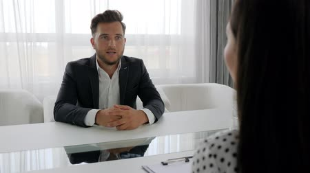 metáfora : Man in depressed Talks about problems with woman, Guilty office worker speak with executive at office, portrait of upset male, conversation of unhappy guy and psychologist sitting at table, Stock Footage