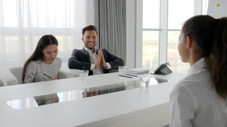 spolupracovníci : business people with glass water on table in conference room, creative team on background white and spacious office, director encourages female employees at break in office