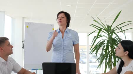 spolupracovníci : positive gesture and clap of successful woman with Colleagues into boardroom on background of white whiteboard and windows in Business center