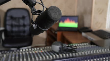 desfocado : mike and mixer broadcast sound control on background of equipment on radio studio close-up, unfocused
