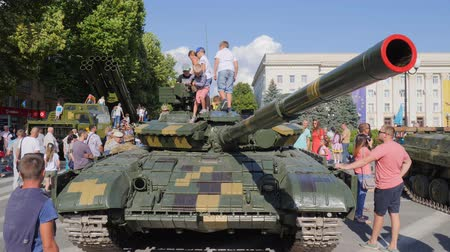 harcias : Kherson, Ukraine 24 August 2017: small children with interest and delight on roof of tank and many people around in Kherson, 24 August 2017 outdoors