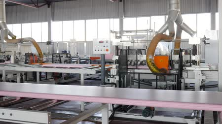 izolace : transportation of plastic along conveyor line at plant with large windows and modern apparatus