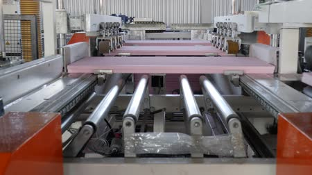 warehouses : production of foam plastic in a large factory, conveyor line in slow motion