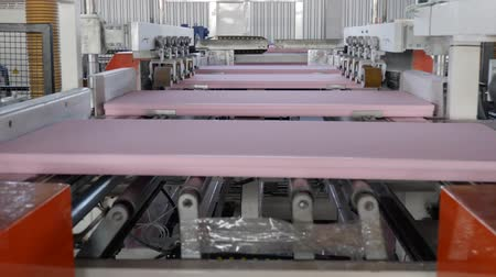 tokarka : conveyor line with styrofoams in motion, industry of foam plastic at large factory