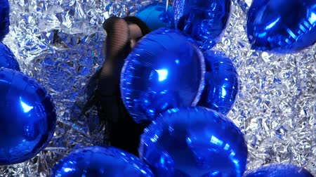 ringlet : women in good mood among inflatable balloons on background of silver wall at evening event