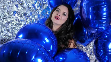 ringlet : party, emotional girl with blue balloons in hands on background shiny wall decorated with foil