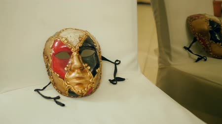 disguise : Kherson, Ukraine 20 October 2017: exhibition of carnival masks for face close-up on white chairs in museum in Kherson, 20 October 2017.