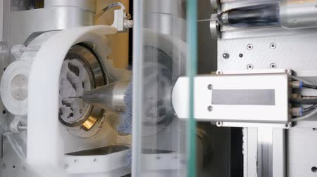 sharp teeth : dental Lab, automatic process of milling out exact shape model of artificial teeth close-up Stock Footage