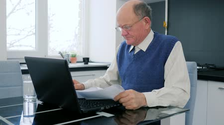 documentation : rageful pensioner businessman throws documents sitting in front of computer in room Stock Footage