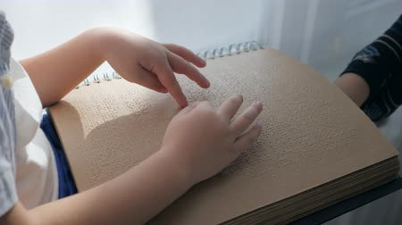 impaired : childrens education, Visually impaired man reading braille book close-up