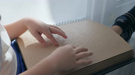 impaired : Visually impaired, braille book in hands of blind man close-up