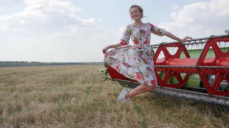 alfândega : beautiful girl into long dress smiling and jumping in air in slow motion on meadow
