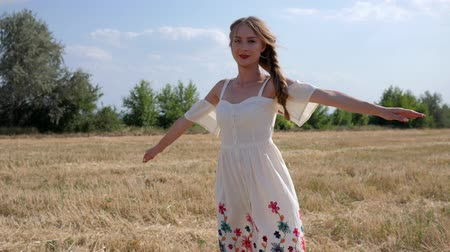 blue braid : young woman into white dress with braid hair Rotates on background of Steppe landscape in Slow motion Stock Footage