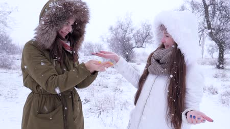 arms in the air : snowing, happy female enjoy snowfall and laughing on open air at winter vacation