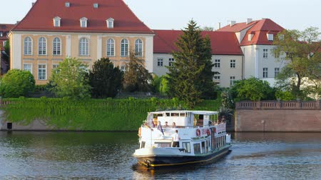 wrocław : Wroclaw, Poland 12 May 2018: excursion on water, pleasure boat with tourists go to water past beautiful town houses in summer in Wroclaw, 12 May 2018.